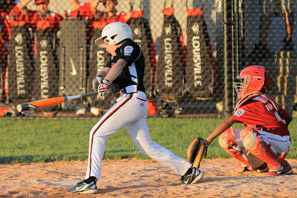 New Albany All-Star Jericho Brooks gets a base hit during Tuesday's District 5, 11U division championship game against Jeff/GRC. Photo by Joe Ullrich