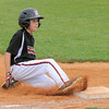 New Albany All-Star Jameson Miller-Embry slides into third base during Monday's District 5, 10/11 year old, pool game against Highlander Youth Recreation. Photo by Joe Ullrich