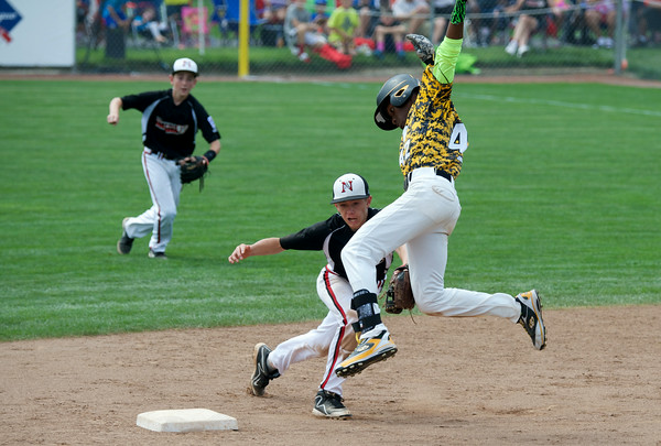 New Albany's Cooper Biven makes the tag on Chicago's Pierce Jones during New Albany's 12-7 loss to Jackie Robinson West in the Great Lakes Region Championship at Indianapolis Saturday.<br /> Staff photo by Tyler Stewart