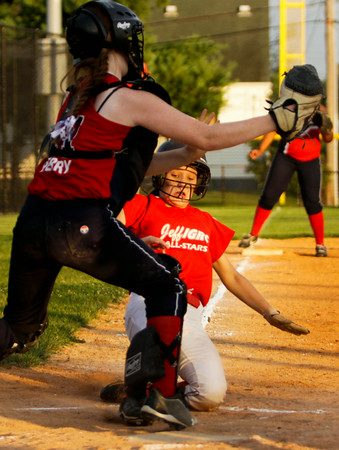 Jeff/GRC's Meghan Lay safely slides into home during Jeff's game against Riverfield in Clarksville on Friday. Staff photo by Christopher Fryer