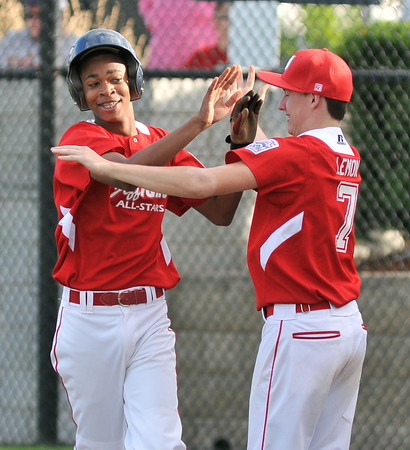Jeff/GRC All-Star Ronald Leslie, left, high five's teamate Jake Lemon after scoring a run during Wednesday's  District 5, 13/14 division championship game against New Albany. Photo by Joe Ullrich