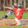 New Albany All-Star Jaxon Murphy applies the tag on Jeff/GRC's Eli Watson for the out at the plate during Tuesday's District 5, 11U division championship game. Photo by Joe Ullrich