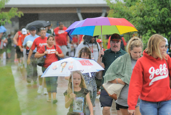 Little League fans leave Clarksville Little League Park after heavy rain postpones Monday night's District 5 Little League Championship game between Jeff/GRC and New Albany. Photo by Joe Ullrich