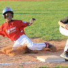Jeff/GRC All-Star Jaylen Fairman slides into third base during Tuesday's District 5, 11U Championship game against New Albany. Photo by Joe Ullrich