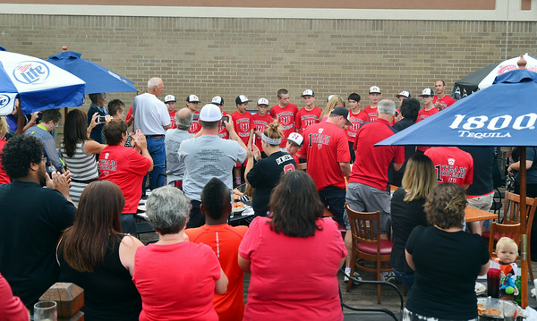 The New Albany 11-12 All Stars are introduced and welcomed onto the patio at Bearno's Pizza off Charlestown Road during the Celebration of Champions Friday evening. The players were available for questions, photos and autographs as part of the welcome home party.<br /> Staff photo by Tyler Stewart