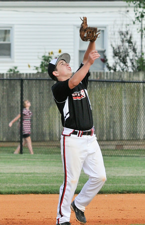 New Albany All-Star second baseman Cole Ryan catches an infield fly ball during Wednesday's  District 5, 13/14 division championship game against Jeff/GRC. Photo by Joe Ullrich