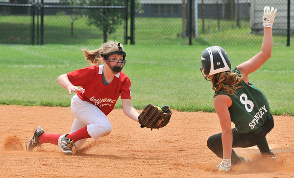 Jeff/GRC All-Star shortstop Hannah Hackworth attempts to tag out Yorktown's Anna Stanley at second base during Sunday's 9/10 year old State Tournament semifinal game. Photo by Joe Ullrich