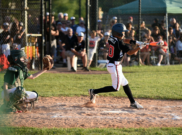 New Albany first baseman Maddox Schmelz connects for a single during the New Albany and HYR 9-10 District 5 All-Star Championship at the Clarksville Little League Park Wednesday evening. New Albany won 5-1.<br /> Staff photo by Tyler Stewart
