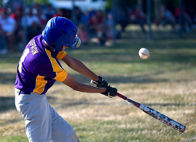 KRISTIN BAUER | CHRONICLE  Avon's Dominic Opron (1) bats against Elyria on Tuesday evening, July 5.