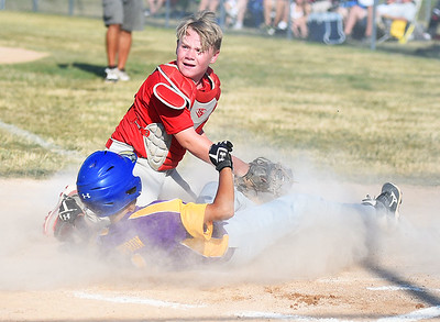 KRISTIN BAUER | CHRONICLE  Elyria's Levi Ellis (9) tags out Avon's Dominic Opron (1) as he slides into home on Tuesday evening, July 5.