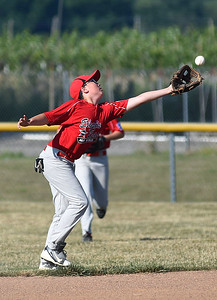 KRISTIN BAUER | CHRONICLE  Elyria shortstop Jacob Gales (1) catches a pop fly hit during a game against Avon on Tuesday evening, July 5.