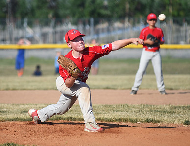 KRISTIN BAUER | CHRONICLE  Elyria's Levi Ellis (9) pitches against Avon on Tuesday evening, July 5.