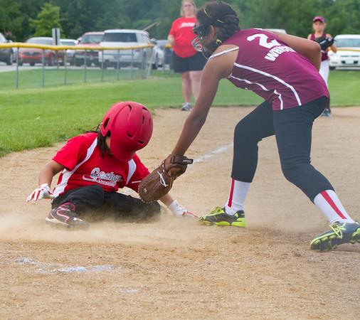 SAM HOUSEHOLDER | THE GOSHEN NEWS<br /> Ari Garcia is safe at home as her helmet slides over her face when she slid during the game against Mishawaka Wednesday.