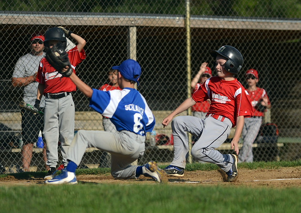 HALEY WARD | THE GOSHEN NEWS <br /> Goshen's Carter Miller slides into home as Bristol pitcher Trevin Schlabach attempts to make the out during the Goshen vs. Bristol game on Friday at the Goshen Little League Park. Miller was safe on the play.