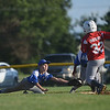 HALEY WARD | THE GOSHEN NEWS <br /> Bristol's Trevin Schlabach dives to tag Goshen's Brady Boocher during the Goshen vs. Bristol game on Friday at the Goshen Little League Park.