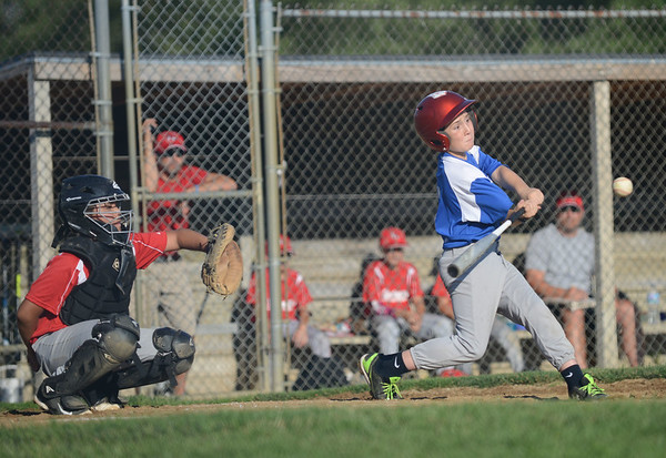 HALEY WARD | THE GOSHEN NEWS <br /> Bristol's Drew Kobryn bats as Goshen's Cesar Vela catches during the Goshen vs. Bristol game on Friday at the Goshen Little League Park.