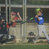 HALEY WARD | THE GOSHEN NEWS <br /> Bristol's Owen Atkinson bats as Goshen's Cesar Vela catches during the Goshen vs. Bristol game on Friday at the Goshen Little League Park.