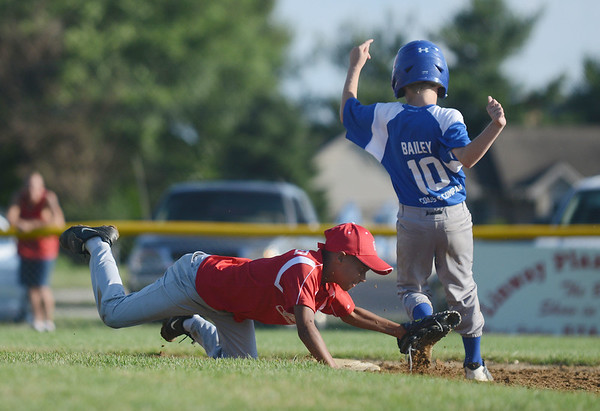 HALEY WARD | THE GOSHEN NEWS <br /> Goshen second baseman Jace Hershberger dives to tag Bristol pitcher Calvin Bailey during the Goshen vs. Bristol game on Friday at the Goshen Little League Park.