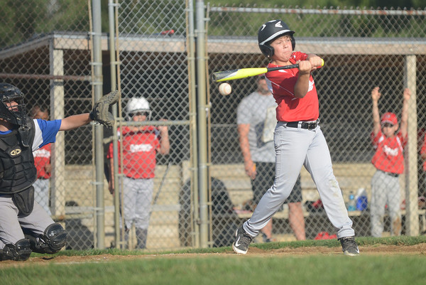 HALEY WARD | THE GOSHEN NEWS <br /> Goshen's Drew Elliott bats during the Goshen vs. Bristol game on Friday at the Goshen Little League Park.
