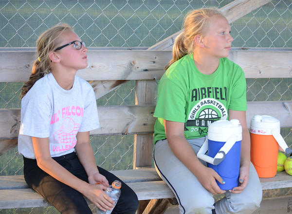 HALEY WARD | THE GOSHEN NEWS <br /> Alexia Hall and Sydney Stutsman listen to their coach following practice on Monday at Hoover Field in New Paris.