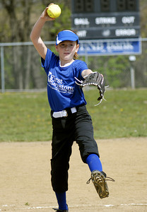 First Keystone's Brittney Toborg sends the ball to the plate during the their first game of Danville's 2012 Little League season Saturday.