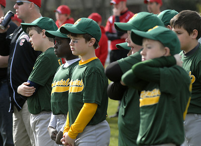 Members of the Continental team listen to Bloomsburg University's baseball coach, Mike Collins, during the opening ceremonies of Danville's 2012 Little League season Saturday at the Washies Little League Complex.