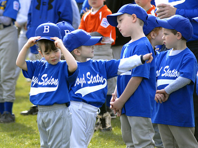 Morgan Gerringer, 4, adjusts her hat while waiting with her team, Boyd Station, for the start of Danville's 2012 Little League season Saturday at the Washies Little League Complex.