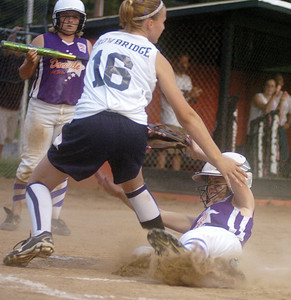 Mifflinburg's Jenna Strawbridge covers the base as Danville's Taylor Brosious slides safely home on Thursday night in Milton.