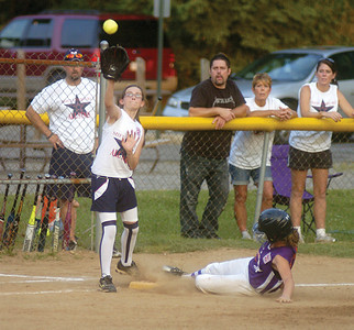 Mifflinburg's Amber Roush makes the catch at the third as Danville's Krista Strausser steals the base during Thrusday softball game in Milton.