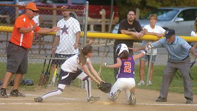 Mifflinburg's Amber Roush can't tag Danville's Allie Metler in time during Thursday's softball game in Milton.