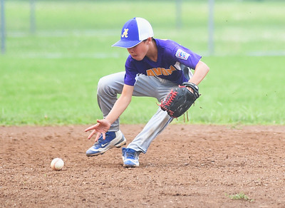 KRISTIN BAUER | CHRONICLE Avon's short stop Evan Garcia (2) fields a ground ball during a game against Elyria on Tuesday evening, July 11.