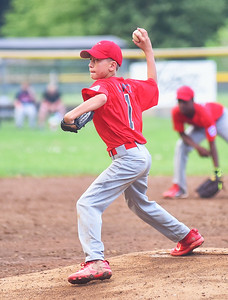 KRISTIN BAUER | CHRONICLE Elyria pitcher Mateo Lopez (1) relief pitches during a game against Avon on Tuesday, July 11.