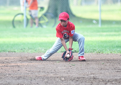 KRISTIN BAUER | CHRONICLE Elyria's shortstop Antonio Troutman (7) fields a ground ball hit during a game against Avon on Tuesday evening, July 11.