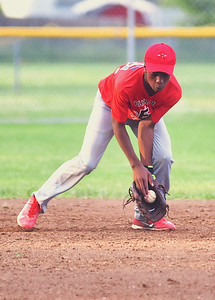 KRISTIN BAUER | CHRONICLE Elyria's shortstop Isaiah Johnson (12) fields a ground ball on Tuesday evening, July 11 during a game against Avon.