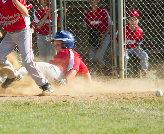 SAM HOUSEHOLDER | THE GOSHEN NEWS<br /> Camden Kercher slides in safe at homeplate during a Goshen Little League All-Stars game Thursday at the Goshen Little League Park.