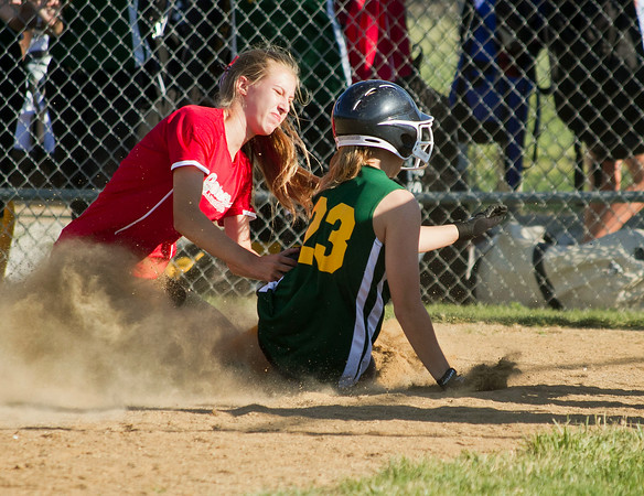 SAM HOUSEHOLDER | THE GOSHEN NEWS<br /> Goshen All-Star softball pitcher Shelby Yoder tags out Middlebury's Taylor Minth Thursday during an All-Stars game at Goshen Little League Park.