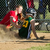 SAM HOUSEHOLDER   THE GOSHEN NEWS<br /> Goshen All-Star softball pitcher Shelby Yoder tags out Middlebury's Taylor Minth Thursday during an All-Stars game at Goshen Little League Park.