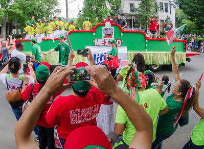Parents and supporter of the Mexico team cheer as the team's flot goes by during the Grand Slam parade on Wednesday.