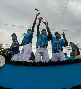 Members of the Caribbean team jump for candy during the Grand Slam parade in Williamsport on Wednesday.