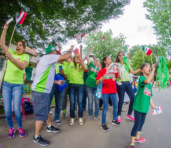 Family and friends of the Mexico team jump up and down as the team's float passes by during the Grand Slam parade on Wednesday in Williamsport.