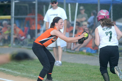Milton pitcher Jillian East tags out Lewisburg's Rachael McVicar along the first baseline during Friday's allstar softball game.