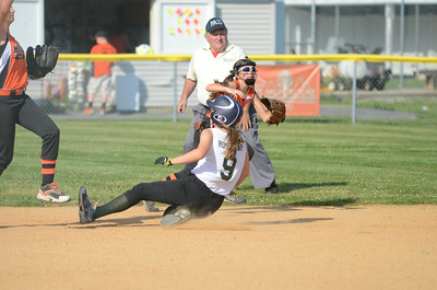 Lewisburg's Grace Rosevear slides safely into second base during Friday's allstar softball game against Milton.