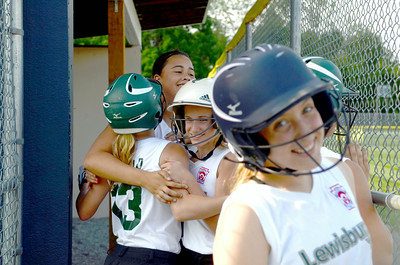 Members of the Lewisburg Girls All Star Softball Team celebrate a run during Friday's game against Milton.