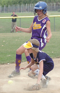 Avon's #21 Kayla Graham makes it safely to 3rd as Tallmadge's #11 Sarah Johnson waits for the ball.