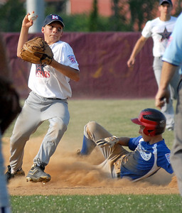 Mifflinburg's Kyle Stoltzfus gets Warrior Run's Michael Muffly out at second before sending the ball to first base during their game Thursday June 28, 2012 at the Monroe Township park.