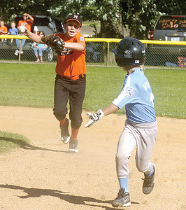 Milton's Dillon Stokes chases down Snyder County's Hunter Wolfe during Tuesday game in Northumberland.
