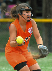 Milton's Taryn Chubb sends the ball to first base during their game against Berwick Saturday June 30, 2012 at Brown Ave. Park in Milton.