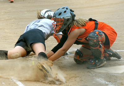 Milton's Kacee Reitz protects the plate and tags Berwick's Tori Tolanco out during their game Saturday June 30, 2012 at Brown Ave. Park in Milton.
