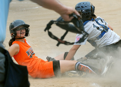 Milton's Sage Graham looks for the call at home sliding in save under Berwick's Brook Stout during their 9-6 win in the District 13 Major Championship Saturday June 30, 2012 at Brown Ave. Park in Milton.