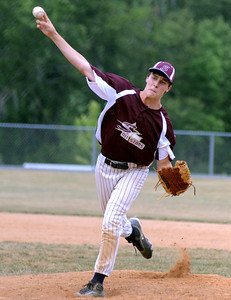 Shik Acorn's Christian Schlegel sends a pitch home during the D13 Junior Division final against Danville Friday July 13, 2012 at Monroe Township Park.